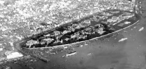 Shameen Island in Canton, largely reclaimed and entirely embanked 1858-61 to create British and French concession areas. Taken from the air in about 1920