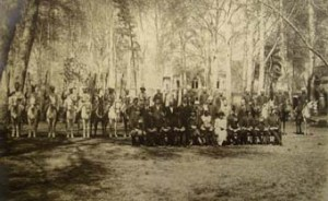 18. Tehran. Min flanked by wife and daughter, staff and escort in the 1920s, among the 50yr old plane trees.
