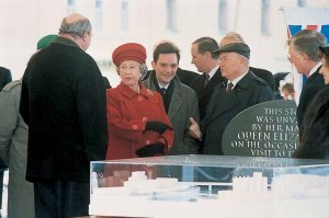 The Mayor of Moscow shows Her Majesty the model of the new embassy. Richard Burton is at left, facing The Queen.