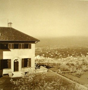 Looking north-west over the valley, with east end of First Building in foreground, 1935.