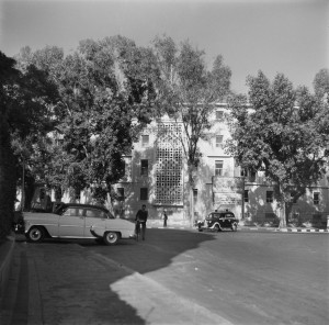 Public view of new offices, 1956, with coat of arms above staircase wiindows and screen.