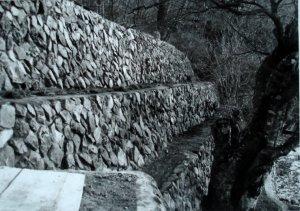 Stone retaining walls, rebuilt 1967.
