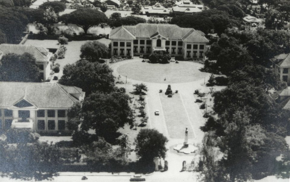 Centre of compound, late 1920s, with entrance gates, War Memorial, Queen Victoria, and minister's residence.