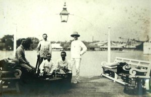 Group on the landing stage, 1890s