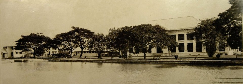 The klong, mid-1920s, with north front of the residence at right and local staff quarters to left.