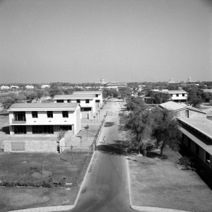 View north from offices, towards residence site, with Lutyens and Baker domes in the distance, 1960.