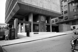 Main office entrance, with large cast aluminium coat of arms by James Woodford, 1970.