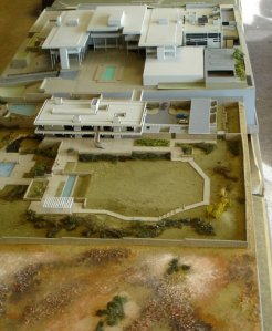 Residence model, 1972, in front of c.1966 model of offices, with 1990 new immigration building model inserted.