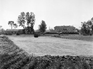 Tennis court under construction, with residence beyond, 1954.