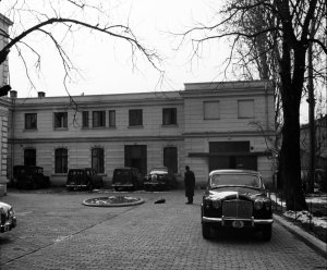 View south, past main building, at left, to former stables block, 1958.