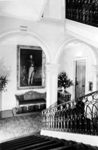 Main stair, with Gen Sir William Beresford on the landing, 1973.