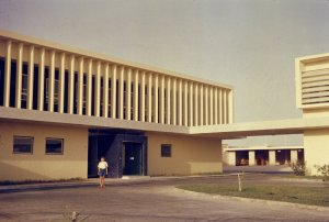 Secondary entrance to offices, with covered walkway to residence, 1968.