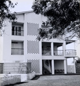 East end of building, with first floor residence terrace around dining and drawing rooms, with stair down to garden,1960s.