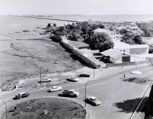Agency compound after construction of new building and before land reclamation along its northern edge, 1960s.